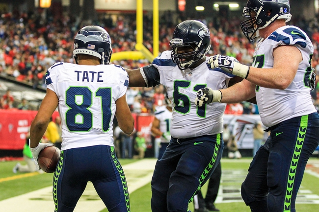 Nov 10, 2013; Atlanta, GA, USA; Seattle Seahawks wide receiver Golden Tate (81) celebrates a touchdown with guard Lemuel Jeanpierre (61) in the first half against the Atlanta Falcons at the Georgia Dome. Mandatory Credit: Daniel Shirey-USA TODAY Sports