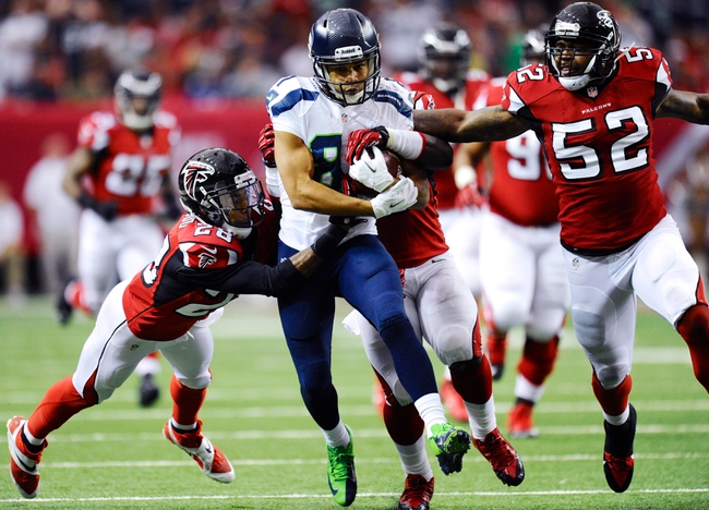 Nov 10, 2013; Atlanta, GA, USA; Seattle Seahawks wide receiver Golden Tate (81) is tackled by Atlanta Falcons safety Thomas DeCoud (28) and linebacker Joplo Bartu (59) and linebacker Akeem Dent (52) after a long gain during the second quarter at the Georgia Dome. Mandatory Credit: Dale Zanine-USA TODAY Sports