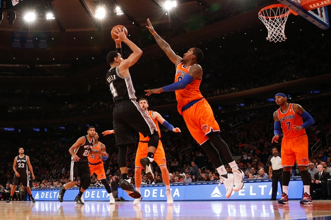 Nov 10, 2013; New York, NY, USA;  San Antonio Spurs shooting guard Danny Green (4) shoots over New York Knicks shooting guard J.R. Smith (8) during the third quarter at Madison Square Garden. Spurs won 120-89.  Mandatory Credit: Anthony Gruppuso-USA TODAY Sports