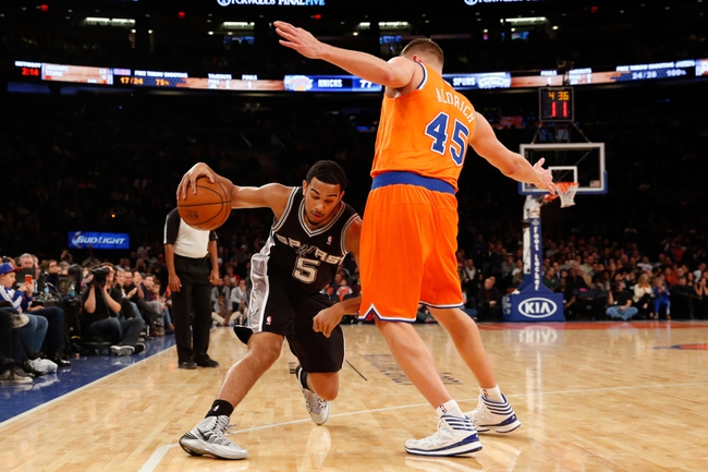 Nov 10, 2013; New York, NY, USA;  San Antonio Spurs point guard Cory Joseph (5) drives under New York Knicks center Cole Aldrich (45) during the fourth quarter at Madison Square Garden. Spurs won 120-89.  Mandatory Credit: Anthony Gruppuso-USA TODAY Sports