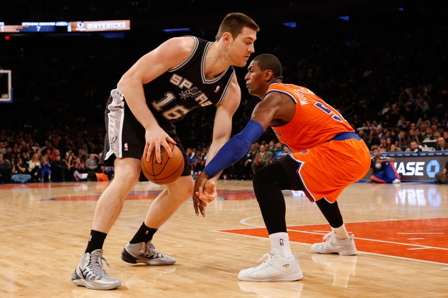 Nov 10, 2013; New York, NY, USA;  San Antonio Spurs power forward Aron Baynes (16) drives around New York Knicks small forward Metta World Peace (51) during the fourth quarter at Madison Square Garden. Spurs won 120-89.  Mandatory Credit: Anthony Gruppuso-USA TODAY Sports
