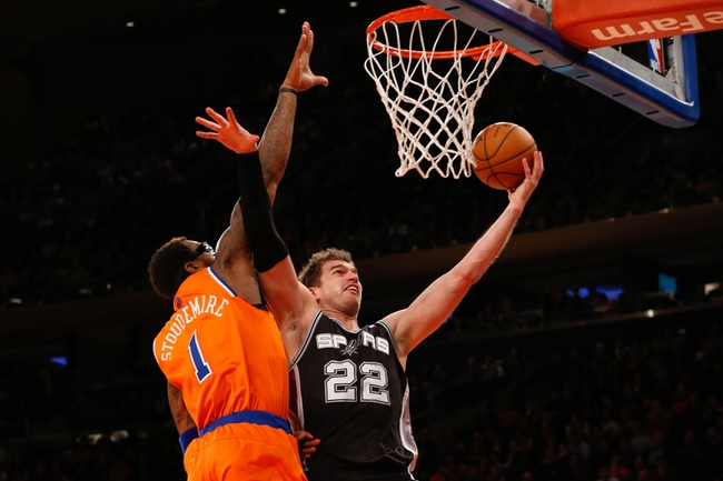 Nov 10, 2013; New York, NY, USA;  San Antonio Spurs center Tiago Splitter (22) drives up to the net as New York Knicks power forward Amar'e Stoudemire (1) defends during the fourth quarter at Madison Square Garden. Spurs won 120-89.  Mandatory Credit: Anthony Gruppuso-USA TODAY Sports