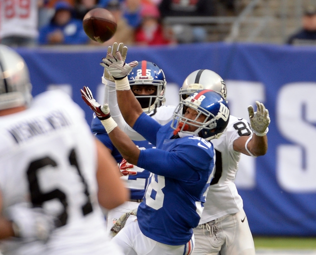 Nov 10, 2013; East Rutherford, NJ, USA; New York Giants cornerback Trumaine McBride (38) breaks up a pass intended for Oakland Raiders wide receiver Rod Streater (80) at MetLife Stadium. Mandatory Credit: Robert Deutsch-USA TODAY Sports
