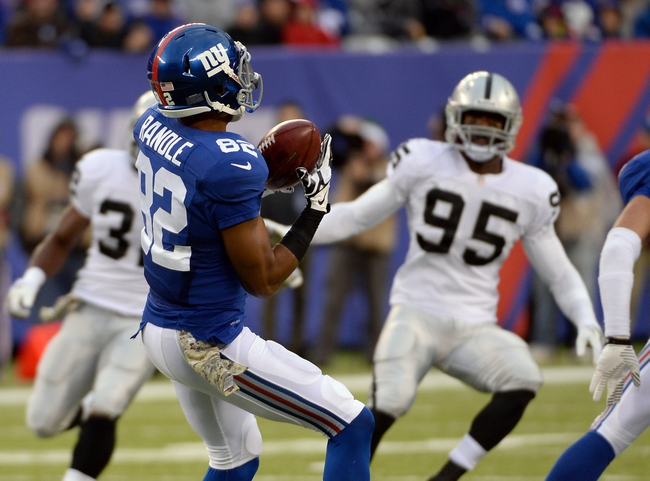 Nov 10, 2013; East Rutherford, NJ, USA; New York Giants wide receiver Rueben Randle (82) catches a pass in the second half against the Oakland Raiders at MetLife Stadium. Mandatory Credit: Robert Deutsch-USA TODAY Sports