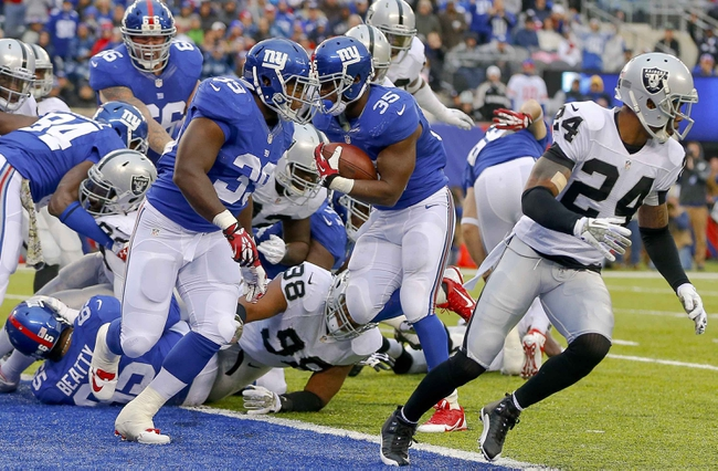 Nov 10, 2013; East Rutherford, NJ, USA;  New York Giants running back Andre Brown (35) runs in for third quarter touchdown against the Oakland Raiders at MetLife Stadium. New York Giants defeat the Oakland Raiders 24-20. Mandatory Credit: Jim O'Connor-USA TODAY Sports
