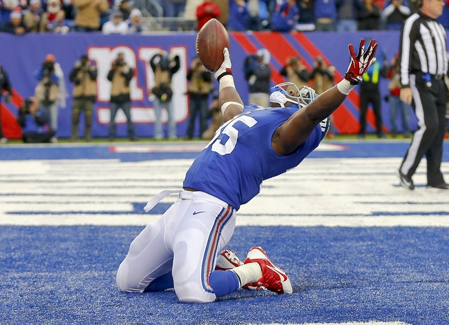 Nov 10, 2013; East Rutherford, NJ, USA;  New York Giants running back Andre Brown (35) celebrates third quarter touchdown against the Oakland Raiders at MetLife Stadium. New York Giants defeat the Oakland Raiders 24-20. Mandatory Credit: Jim O'Connor-USA TODAY Sports