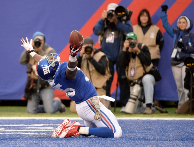 Nov 10, 2013; East Rutherford, NJ, USA; New York Giants running back Andre Brown (35) celebrates scoring a touchdown against the Oakland Raiders at MetLife Stadium. Mandatory Credit: Robert Deutsch-USA TODAY Sports