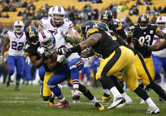 Nov 10, 2013; Pittsburgh, PA, USA; Buffalo Bills wide receiver Marquise Goodwin (88) is tackled by the Steelers defense including cornerback Ike Taylor (24) and defensive end Ziggy Hood (96) during the fourth quarter against at Heinz Field.  The Pittsburgh Steelers won 23-10. Mandatory Credit: Charles LeClaire-USA TODAY Sports