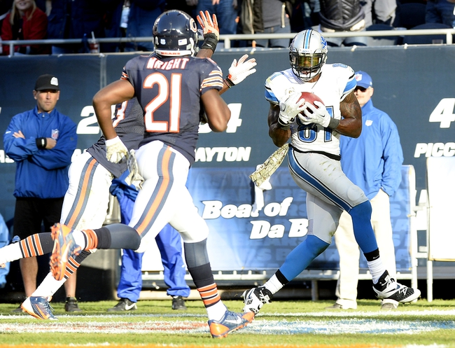 Nov 10, 2013; Chicago, IL, USA; Detroit Lions wide receiver Calvin Johnson (81) scores the winning touchdown against Chicago Bears cornerback Charles Tillman (33) and strong safety Major Wright (21)during the second half at Soldier Field. Detroit defeats Chicago 21-19. Mandatory Credit: Mike DiNovo-USA TODAY Sports