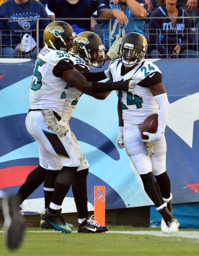 Nov 10, 2013; Nashville, TN, USA; Jacksonville Jaguars cornerback Will Blackmon (24) celebrates with teammates after scoring a touchdown against the Tennessee Titans during the second half at LP Field. The Jaguars beat the Titans 29-27. Mandatory Credit: Don McPeak-USA TODAY Sports