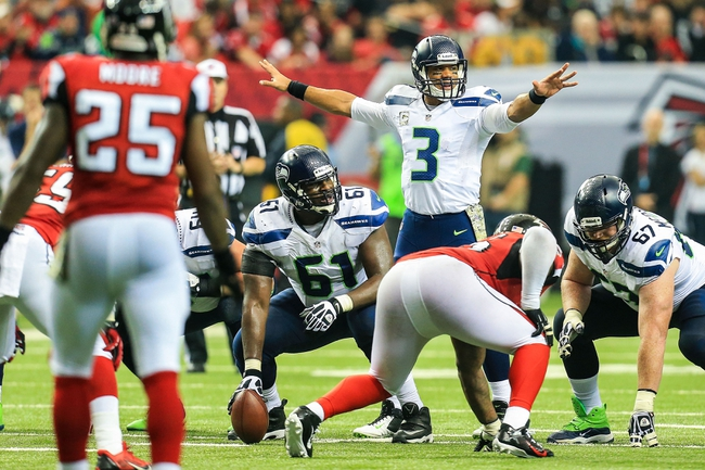 Nov 10, 2013; Atlanta, GA, USA; Seattle Seahawks quarterback Russell Wilson (3) calls a play at the line in the second half against the Atlanta Falcons at the Georgia Dome. The Seahawks won 33-10. Mandatory Credit: Daniel Shirey-USA TODAY Sports