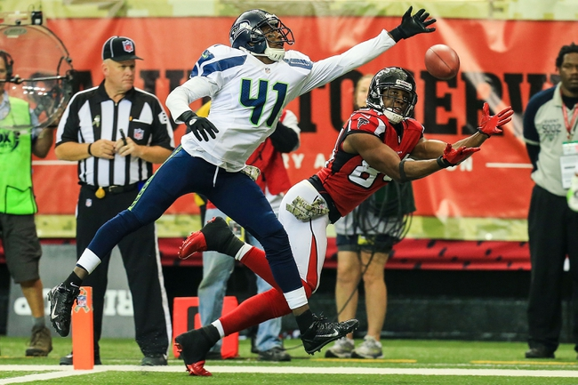 Nov 10, 2013; Atlanta, GA, USA; Atlanta Falcons wide receiver Roddy White (84) attempts to make a catch in the end zone with coverage by Seattle Seahawks cornerback Byron Maxwell (41) in the second half at the Georgia Dome. The Seahawks won 33-10. Mandatory Credit: Daniel Shirey-USA TODAY Sports