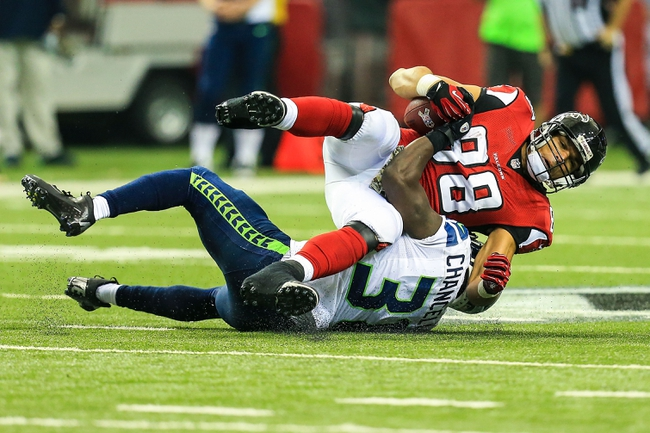 Nov 10, 2013; Atlanta, GA, USA; Atlanta Falcons tight end Tony Gonzalez (88) is tackled by Seattle Seahawks safety Kam Chancellor (31) after a catch in the second half at the Georgia Dome. The Seahawks won 33-10. Mandatory Credit: Daniel Shirey-USA TODAY Sports