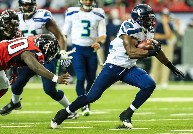 Nov 10, 2013; Atlanta, GA, USA; Seattle Seahawks running back Robert Turbin (22) runs the ball in the second half against the Atlanta Falconsat the Georgia Dome. The Seahawks won 33-10. Mandatory Credit: Daniel Shirey-USA TODAY Sports