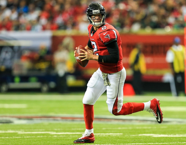 Nov 10, 2013; Atlanta, GA, USA; Atlanta Falcons quarterback Matt Ryan (2) rolls out on a pass play in the second half against the Seattle Seahawks at the Georgia Dome. The Seahawks won 33-10. Mandatory Credit: Daniel Shirey-USA TODAY Sports