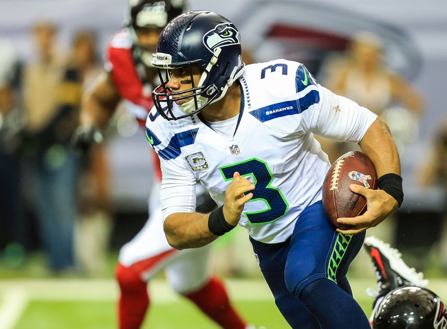Nov 10, 2013; Atlanta, GA, USA; Seattle Seahawks quarterback Russell Wilson (3) scrambles away from pressure in the second half against the Atlanta Falcons at the Georgia Dome. The Seahawks won 33-10. Mandatory Credit: Daniel Shirey-USA TODAY Sports