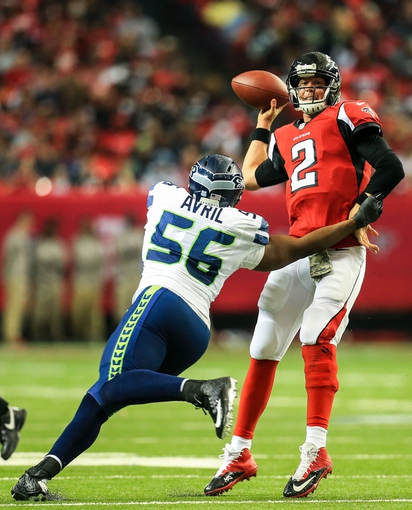 Nov 10, 2013; Atlanta, GA, USA; Atlanta Falcons quarterback Matt Ryan (2) throws the ball away under pressure from Seattle Seahawks defensive end Cliff Avril (56) in the second half at the Georgia Dome. The Seahawks won 33-10. Mandatory Credit: Daniel Shirey-USA TODAY Sports