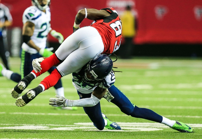 Nov 10, 2013; Atlanta, GA, USA; Seattle Seahawks cornerback Richard Sherman (25) tackles Atlanta Falcons wide receiver Harry Douglas (83) in the second half at the Georgia Dome. The Seahawks won 33-10. Mandatory Credit: Daniel Shirey-USA TODAY Sports