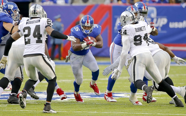 Nov 10, 2013; East Rutherford, NJ, USA;  New York Giants running back Andre Brown (35) finds hole in Oakland Raiders line during the second half at MetLife Stadium. New York Giants defeat the Oakland Raiders 24-20. Mandatory Credit: Jim O'Connor-USA TODAY Sports