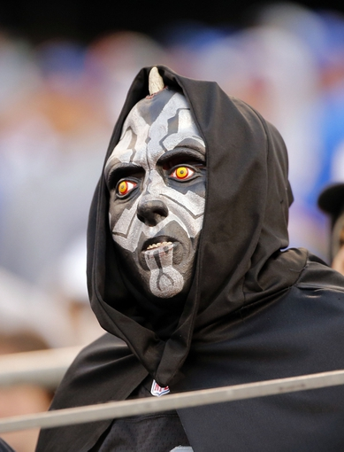 Nov 10, 2013; East Rutherford, NJ, USA;  Oakland Raiders  fan during the second half of game against the New York Giants at MetLife Stadium. New York Giants defeat the Oakland Raiders 24-20. Mandatory Credit: Jim O'Connor-USA TODAY Sports