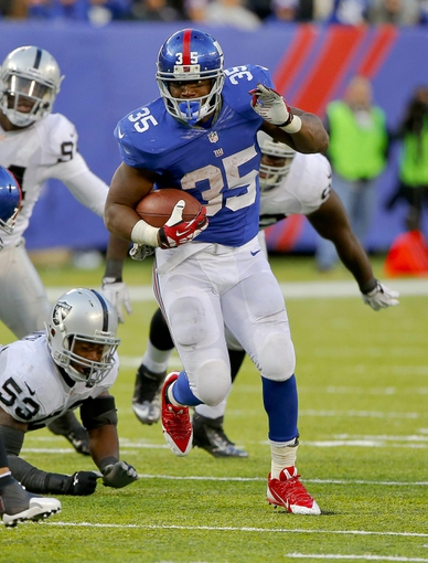 Nov 10, 2013; East Rutherford, NJ, USA;  New York Giants running back Andre Brown (35) during the second half against the Oakland Raiders at MetLife Stadium. New York Giants defeat the Oakland Raiders 24-20. Mandatory Credit: Jim O'Connor-USA TODAY Sports