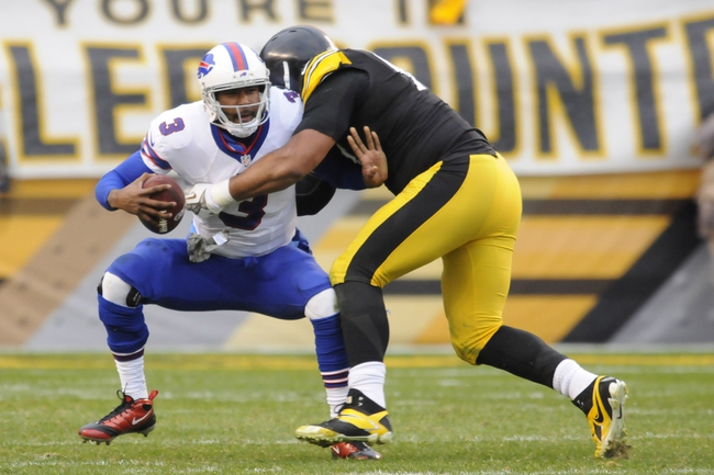 Nov 10, 2013; Pittsburgh, PA, USA; Buffalo Bills quarterback EJ Manuel (3) is sacked by Pittsburgh Steelers defensive end Cameron Heyward (97) during the fourth quarter of a game at Heinz Field. Mandatory Credit: Mark Konezny-USA TODAY Sports