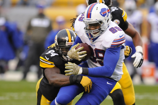Nov 10, 2013; Pittsburgh, PA, USA; Buffalo Bills tight end Chris Gragg (89) is tackled by Pittsburgh Steelers inside linebacker Lawrence Timmons (94) after making a catch during the fourth quarter of a game at Heinz Field. Pittsburgh won the game 23-10. Mandatory Credit: Mark Konezny-USA TODAY Sports