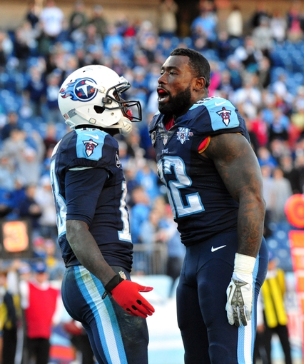 Nov 10, 2013; Nashville, TN, USA; Tennessee Titans tight end Delanie Walker (82) celebrates with Titans wide receiver Kendall Wright (13) after Walker (82) caught a touchdown pass against the Jacksonville Jaguars  during the second half at LP Field. The Jaguars beat the Titans 29-27. Mandatory Credit: Don McPeak-USA TODAY Sports