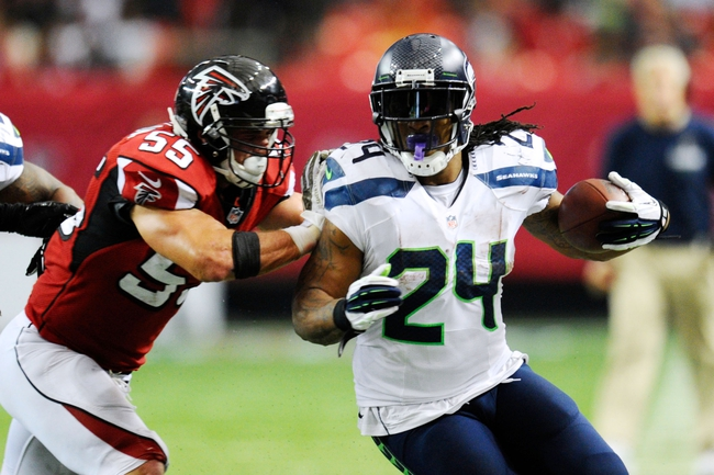 Nov 10, 2013; Atlanta, GA, USA; Seattle Seahawks running back Marshawn Lynch (24) is pushed out of bounds by Atlanta Falcons linebacker Paul Worrilow (55) during the second half at the Georgia Dome. The Seahawks defeated the Falcons 33-10. Mandatory Credit: Dale Zanine-USA TODAY Sports