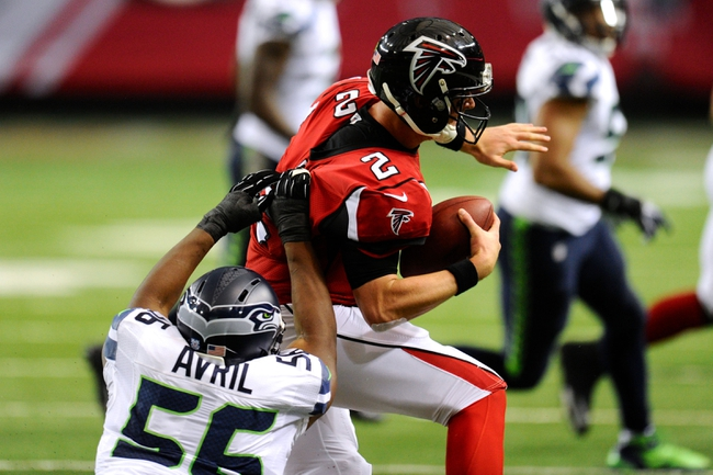 Nov 10, 2013; Atlanta, GA, USA; Seattle Seahawks defensive end Cliff Avril (56) is called for a horse collar tackle against Atlanta Falcons quarterback Matt Ryan (2) during the second half at the Georgia Dome. The Seahawks defeated the Falcons 33-10. Mandatory Credit: Dale Zanine-USA TODAY Sports