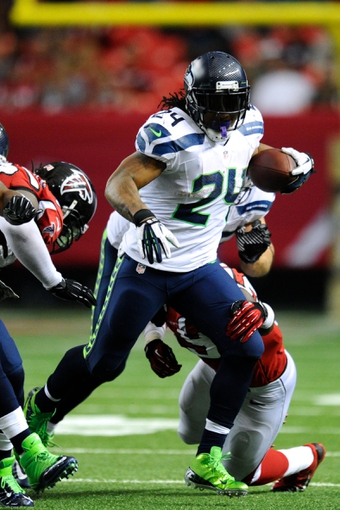 Nov 10, 2013; Atlanta, GA, USA; Seattle Seahawks running back Marshawn Lynch (24) runs the ball against the Atlanta Falcons during the second half at the Georgia Dome. The Seahawks defeated the Falcons 33-10. Mandatory Credit: Dale Zanine-USA TODAY Sports