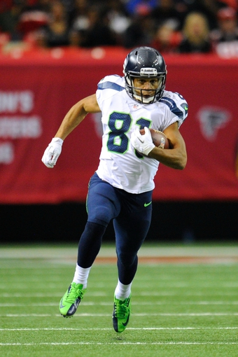 Nov 10, 2013; Atlanta, GA, USA; Seattle Seahawks wide receiver Golden Tate (81) runs with the ball after a catch against the Atlanta Falcons during the second half at the Georgia Dome. The Seahawks defeated the Falcons 33-10. Mandatory Credit: Dale Zanine-USA TODAY Sports