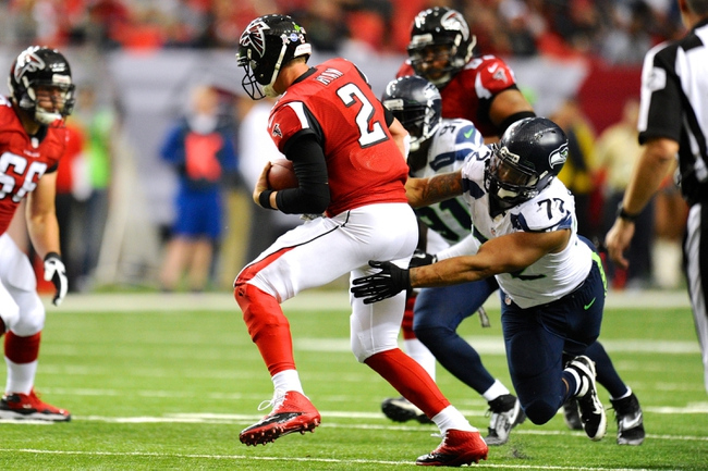Nov 10, 2013; Atlanta, GA, USA; Seattle Seahawks defensive end Michael Bennett (72) sacks Atlanta Falcons quarterback Matt Ryan (2) during the second half at the Georgia Dome. The Seahawks defeated the Falcons 33-10. Mandatory Credit: Dale Zanine-USA TODAY Sports