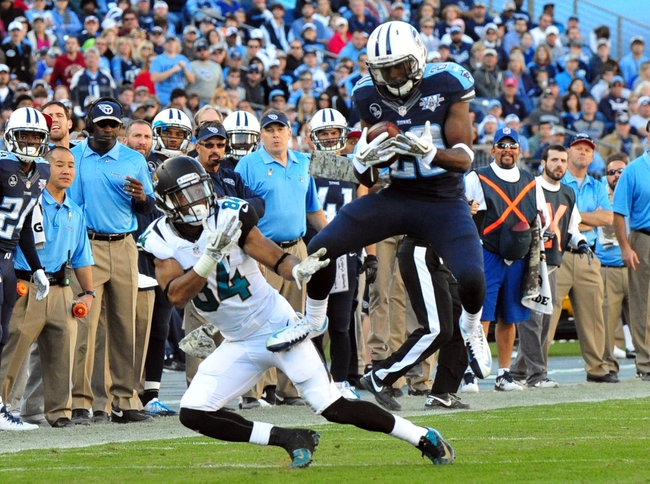 Nov 10, 2013; Nashville, TN, USA; Tennessee Titans cornerback Alaterraun Verner (20) intercepts a pass intended for Jacksonville Jaguars wide receiver Cecil Shorts III during the second half at LP Field. The Jaguars beat the Titans 29-27. Mandatory Credit: Don McPeak-USA TODAY Sports