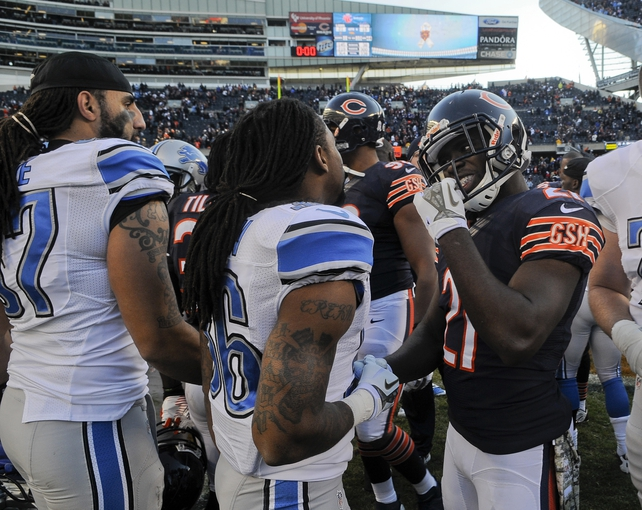 Nov 10, 2013; Chicago, IL, USA;  Detroit Lions cornerback Jonte Green (36) and Chicago Bears strong safety Major Wright (21) talk after the Lions beat the Bears 21-19 at Soldier Field. Mandatory Credit: Matt Marton-USA TODAY Sports