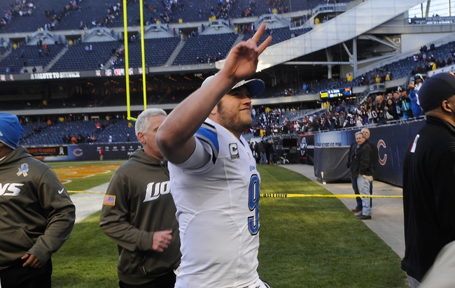 Nov 10, 2013; Chicago, IL, USA;  Detroit Lions quarterback Matthew Stafford (9) waves to fans after the Lions beat the Bears 21-19 at Soldier Field. Mandatory Credit: Matt Marton-USA TODAY Sports