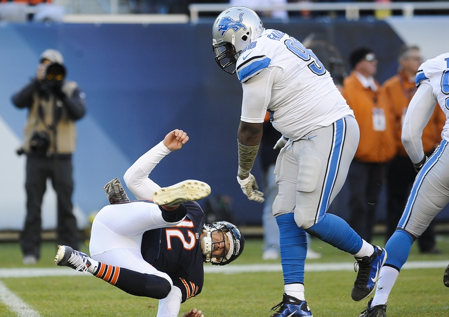 Nov 10, 2013; Chicago, IL, USA;  Chicago Bears quarterback Josh McCown (12) gets flipped down by Detroit Lions defensive tackle Nick Fairley (98) at Soldier Field. Mandatory Credit: Matt Marton-USA TODAY Sports