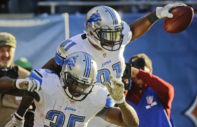 Nov 10, 2013; Chicago, IL, USA;  Detroit Lions running back Joique Bell (35) and Detroit Lions wide receiver Calvin Johnson (81) celebrate Johnson's 2nd-half touchdown against the Bears at Soldier Field. Mandatory Credit: Matt Marton-USA TODAY Sports