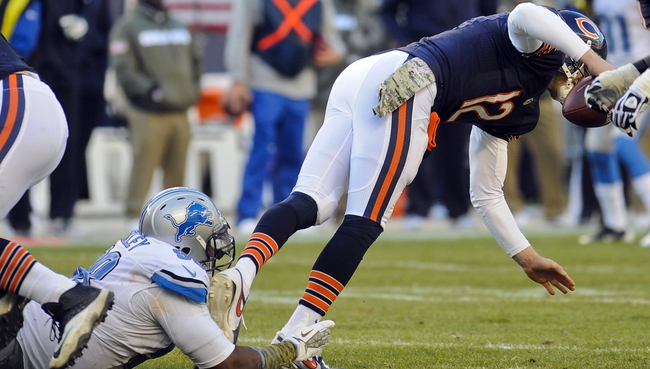 Nov 10, 2013; Chicago, IL, USA;  Chicago Bears quarterback Josh McCown (12) gets sacked by Detroit Lions defensive tackle Nick Fairley (98) at Soldier Field. Mandatory Credit: Matt Marton-USA TODAY Sports