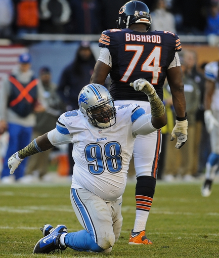 Nov 10, 2013; Chicago, IL, USA;  Detroit Lions defensive tackle Nick Fairley (98) after sacking Chicago Bears quarterback Josh McCown (12) at Soldier Field. Mandatory Credit: Matt Marton-USA TODAY Sports