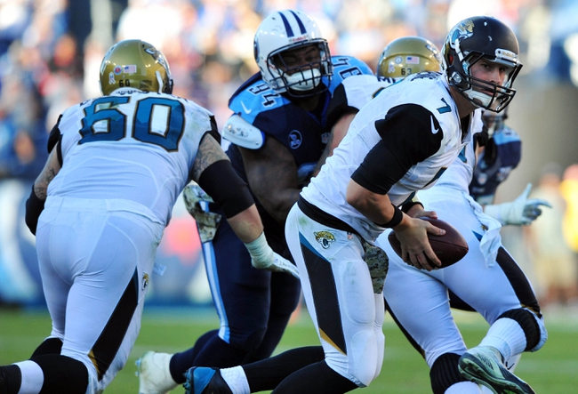 Nov 10, 2013; Nashville, TN, USA; Jacksonville Jaguars quarterback Chad Henne (7) drops back to hand off against the Tennessee Titans during the second half at LP Field. The Jaguars beat the Titans 29-27. Mandatory Credit: Don McPeak-USA TODAY Sports