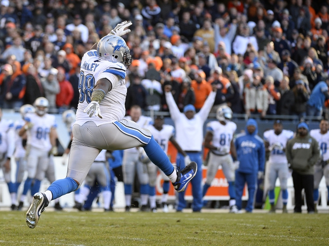 Nov 10, 2013; Chicago, IL, USA; Detroit Lions defensive tackle Nick Fairley (98) reacts after tackling Chicago Bears running back Matt Forte (not pictured) during the second half at Soldier Field. Detroit defeats Chicago 21-19. Mandatory Credit: Mike DiNovo-USA TODAY Sports