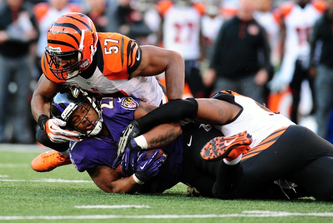 Nov 10, 2013; Baltimore, MD, USA; Baltimore Ravens running back Ray Rice (27) gets tackled by Cincinnati Bengals linebacker Vincent Rey (57) at M&T Bank Stadium. Mandatory Credit: Evan Habeeb-USA TODAY Sports