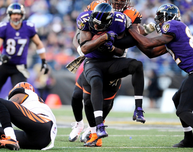 Nov 10, 2013; Baltimore, MD, USA; Baltimore Ravens wide receiver Jacoby Jones (12) gets tackled by Cincinnati Bengals linebacker Vontaze Burfict (55) at M&T Bank Stadium. Mandatory Credit: Evan Habeeb-USA TODAY Sports