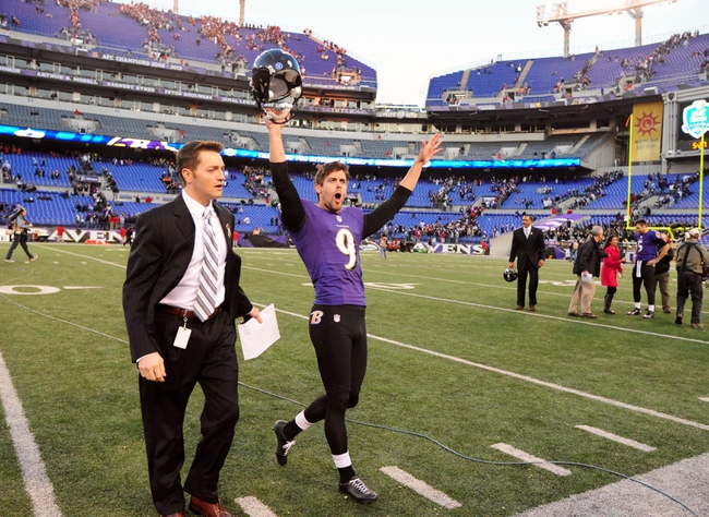 Nov 10, 2013; Baltimore, MD, USA; Baltimore Ravens kicker Justin Tucker (9) celebrates after kicking the game winning field goal in overtime to beat the Cincinnati Bengals 20-17 at M&T Bank Stadium. Mandatory Credit: Evan Habeeb-USA TODAY Sports