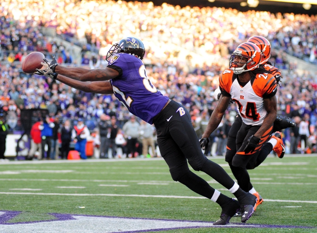 Nov 10, 2013; Baltimore, MD, USA; Baltimore Ravens wide receiver Torrey Smith (82) dives but cannot make the catch over Cincinnati Bengals cornerback Adam Jones (24) at M&T Bank Stadium. Mandatory Credit: Evan Habeeb-USA TODAY Sports