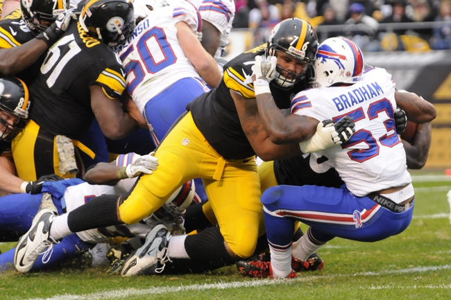 Nov 10, 2013; Pittsburgh, PA, USA; Pittsburgh Steelers tackle Mike Adams (76) puts a block on Buffalo Bills outside linebacker Nigel Bradham (53) at the goal line during the third quarter of a game at Heinz Field. Pittsburgh won the game 23-10. Mandatory Credit: Mark Konezny-USA TODAY Sports