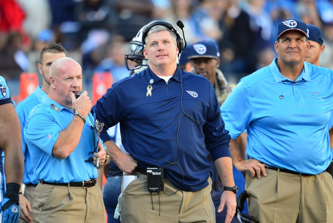 Nov 10, 2013; Nashville, TN, USA; Tennessee Titans head coach Mike Munchak watches a replay on the jumbotron in a game against the Jacksonville Jaguars during the second half at LP Field. The Jaguars beat the Titans 29-27. Mandatory Credit: Don McPeak-USA TODAY Sports