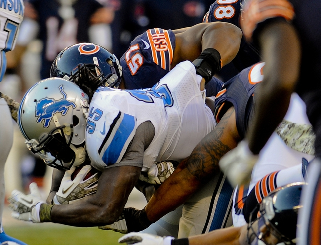 Nov 10, 2013; Chicago, IL, USA;  Detroit Lions running back Joique Bell (35) gets tackled by Chicago Bears inside linebacker Jon Bostic (57) at Soldier Field. Mandatory Credit: Matt Marton-USA TODAY Sports