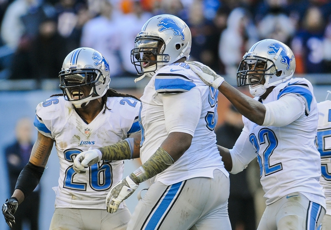 Nov 10, 2013; Chicago, IL, USA;  Detroit Lions defensive tackle Nick Fairley (98) and Detroit Lions free safety Louis Delmas (26) Detroit Lions strong safety Don Carey (32) and Detroit Lions outside linebacker DeAndre Levy (54) celebrate after he sacks Chicago Bears quarterback Josh McCown (12) in the 4th quarter at Soldier Field. Mandatory Credit: Matt Marton-USA TODAY Sports